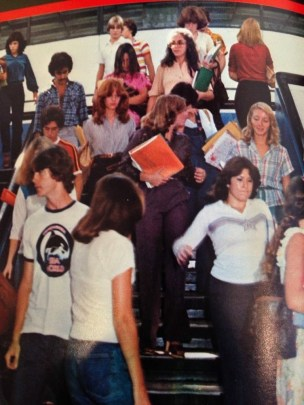 A page from Patricia's yearbook, 1980. She can be seen descending the stairs in a blue shirt.